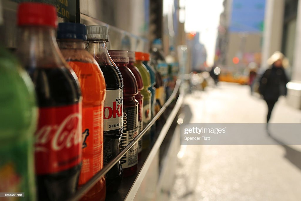 Bottles of soda are displayed on a shelf on January 23, 2013 in New York City. As American consumers continue to shift to water, coffee, and other drinks, soda sales have fallen in the U.S. Soda sales in volume dropped 1.8% last year to $28.70 billion. In New York Mayor Michael Bloomberg has a launched a campaign and passed a ban on extra large-size sodas, which his administration has linked to diabetes and obesity.
