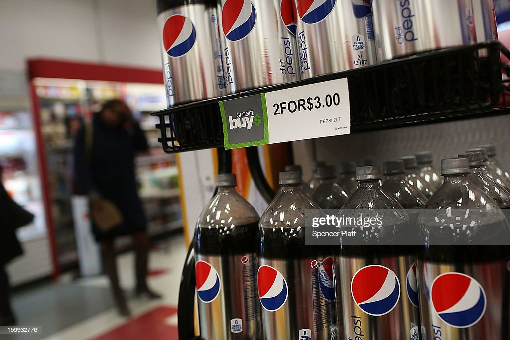 Bottles of soda are displayed on the shelf of a store on January 23, 2013 in New York City. As American consumers continue to shift to water, coffee, and other drinks, soda sales have fallen in the U.S. Soda sales in volume dropped 1.8% last year to $28.70 billion. In New York Mayor Michael Bloomberg has a launched a campaign and passed a ban on extra large-size sodas, which his administration has linked to diabetes and obesity.