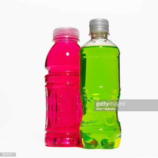 bottles of soft drink - energy drink stock pictures, royalty-free photos & images