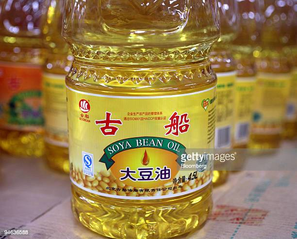 Bottles of soybean oil are for sale at a supermarket in Beijing China on Monday Dec 17 2007 China the world's biggest vegetable oil consumer doubled...