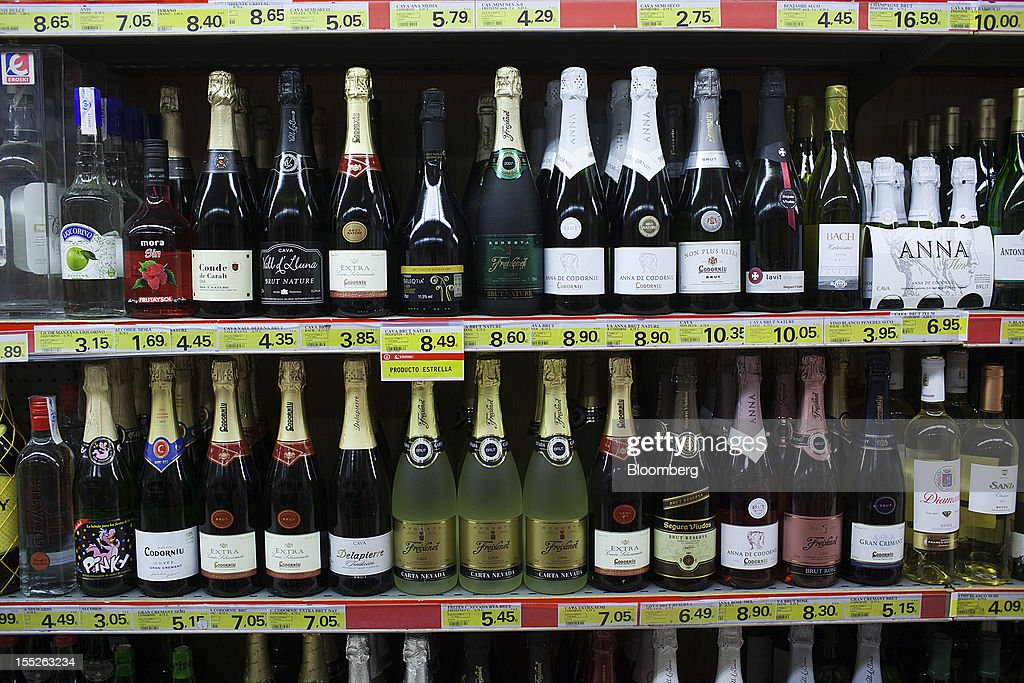 Bottles of Spanish cava wine sit on shelves at an Eroski Group supermarket in Madrid, Spain, on Friday, Nov. 2, 2012. Spain is unlikely to need a full bailout while any request from the euro area's fourth-largest economy for alternative support measures must be met with a swift response, Finnish Prime Minister Jyrki Katainen said. Photographer: Angel Navarrete/Bloomberg via Getty Images