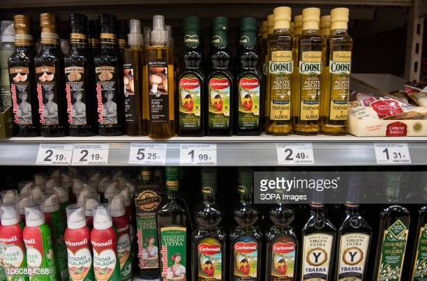 Bottles of Spanish olive oil are displayed for sale at a Carrefour supermarket in Spain