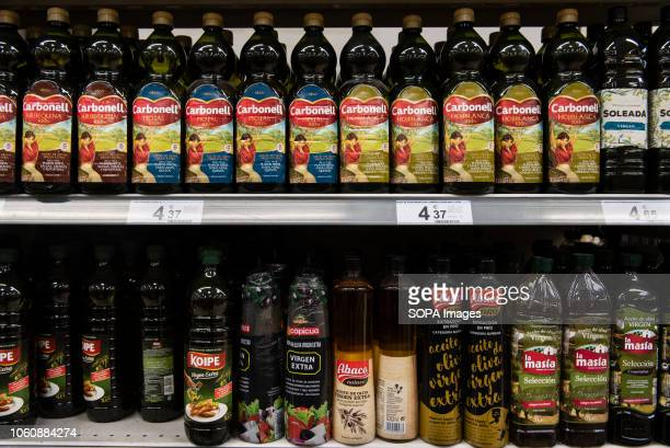 Bottles of Spanish olive oil are seen displayed for sale at a Carrefour supermarket in Spain