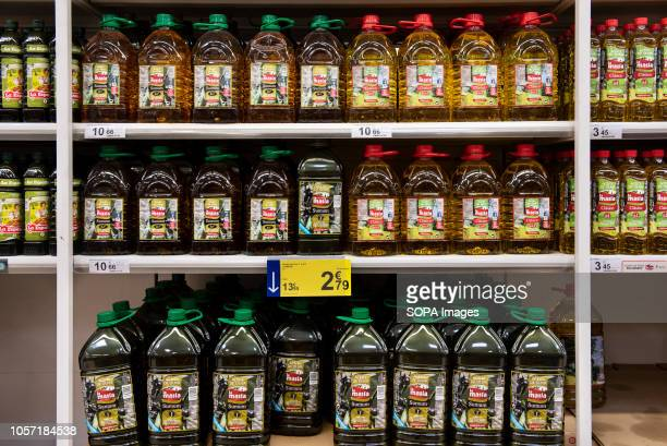 Bottles of Spanish olive oil are seen displayed for sale at the Carrefour supermarket in Spain