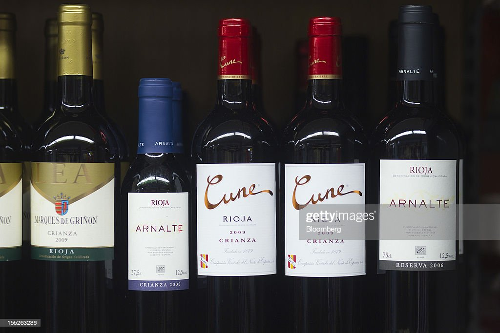 Bottles of Spanish red wine, including rioja, sit on a shelf at an Eroski Group supermarket in Madrid, Spain, on Friday, Nov. 2, 2012. Spain is unlikely to need a full bailout while any request from the euro area's fourth-largest economy for alternative support measures must be met with a swift response, Finnish Prime Minister Jyrki Katainen said. Photographer: Angel Navarrete/Bloomberg via Getty Images
