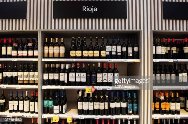 Bottles of Spanish Rioja red wine are seen displayed for sale at the Carrefour supermarket in Spain