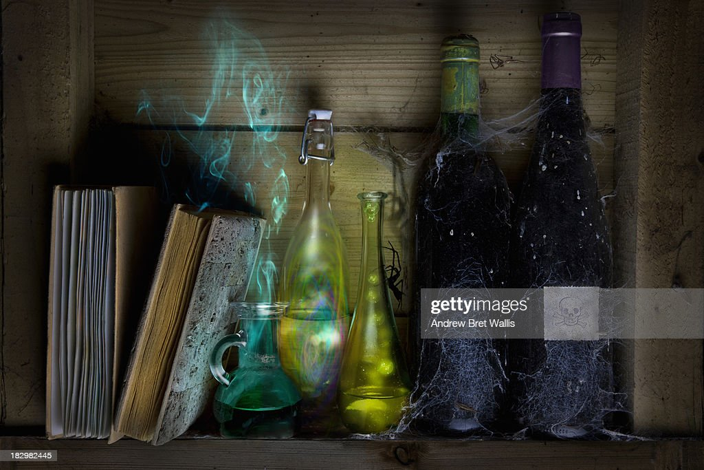 Bottles of spells and potions and books of magic : Stock Photo