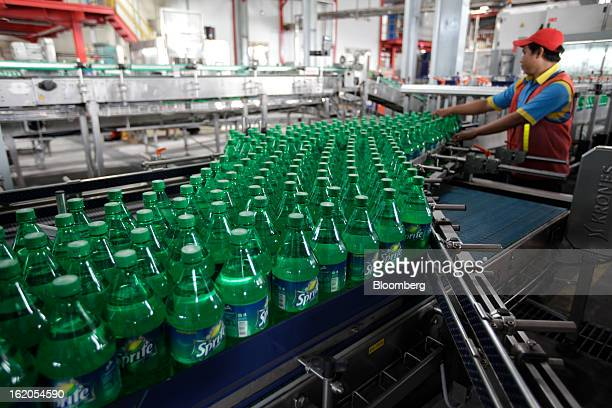 Bottles of Sprite move along a conveyor belt at a CocaCola Amatil Ltd plant in Medan North Sumatra province Indonesia on Friday Feb 15 2013 CocaCola...