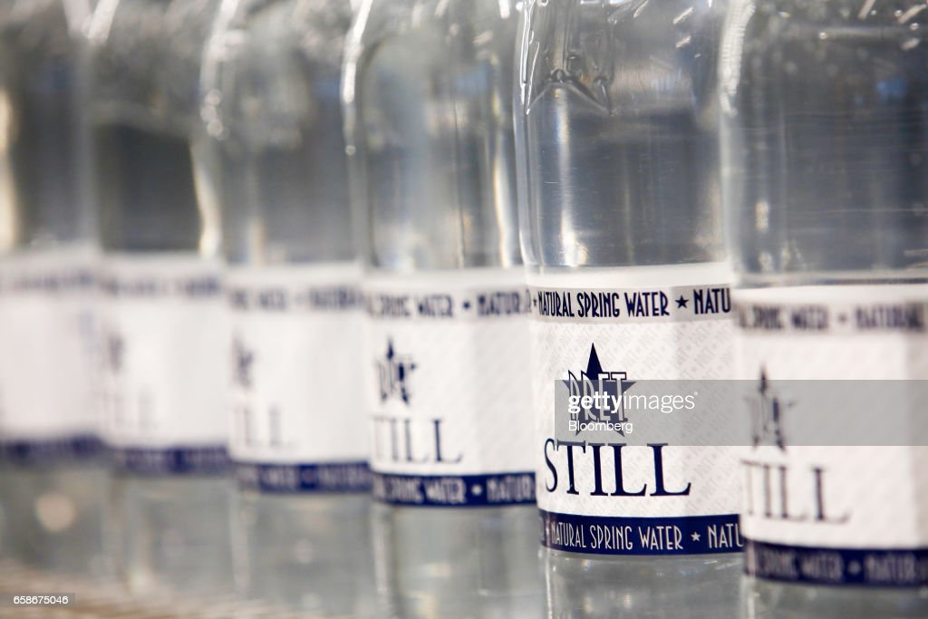 Bottles of still water branded with the Pret logo sit on sale inside a branch of food retailer Pret a Manger Ltd. in London, U.K., on Monday, March 27, 2017. Food chain Pret a Manger said it's concerned about Brexit because just one in 50 applicants seeking jobs is British. Photographer: Luke MacGregor/Bloomberg via Getty Images