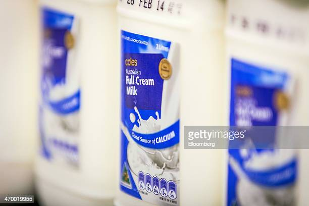 Bottles of storebrand fullcream milk are displayed for sale in the dairy section of a Coles supermarket operated by Wesfarmers Ltd in Sydney...