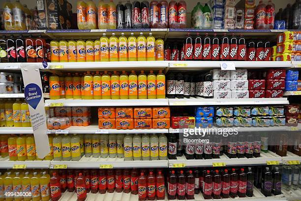 Bottles of sugarfree and regular fizzy soft drinks sit sidebyside on display at the Tesco Basildon Pitsea Extra supermarket operated by Tesco Plc in...