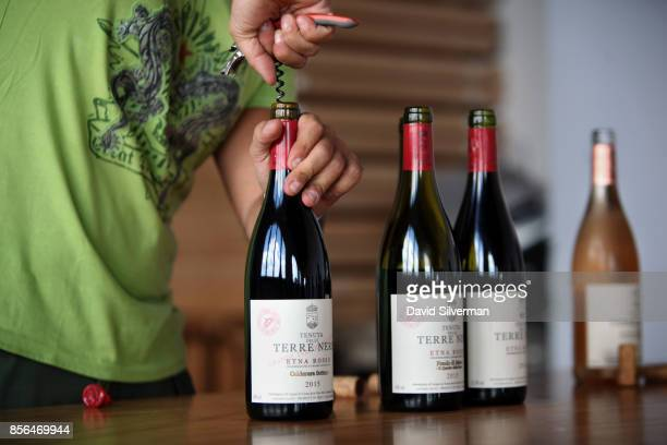 Bottles of Tenuta delle Terre Nere's Etna Rosso DOC red wines are opened for tasting at the winery located on the northern slope of the Mt Etna...