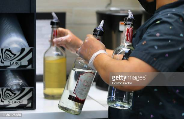 Bottles of tequila, rum and vodka for the frozen drinks at the new Taco Bell Cantina in Brookline, MA on Dec. 4, 2020. The new Taco Bell on Boston...