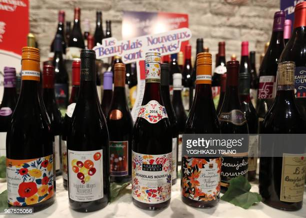Bottles of the 2016 vintage Beaujolais Nouveau wine are displayed at a countdown event in Tokyo on November 17 after an embargo on the wine was...