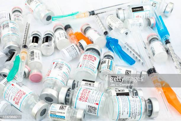 Bottles of the three current COVID-19 vaccines from Johnson & Johnson, Moderna and Pfizer, with hypodermics needles, photographed at the COVID-19...