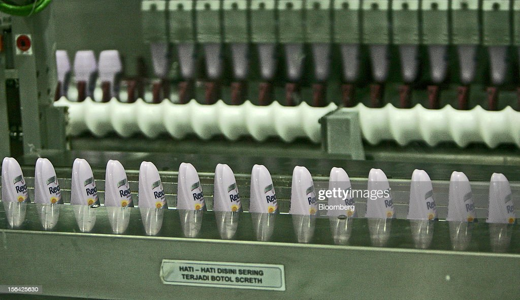 Bottles of Unilever NV's Rexona line of skincare products move along the production line at the company's factory in Cikarang, Indonesia, on Wednesday, Nov. 14, 2012. Unilever has accelerated the rollout of shampoos and deodorants to emerging markets such as Indonesia and China to offset slowing growth in developed markets, where higher price tags have deterred consumers. Photographer: Dadang Tri/Bloomberg via Getty Images