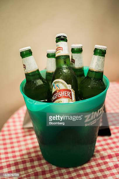 Bottles of United Breweries Ltd Kingfisher beer are arranged for a photograph at a bar in New Delhi India on Sept 27 2012 Diageo Plc confirmed that...