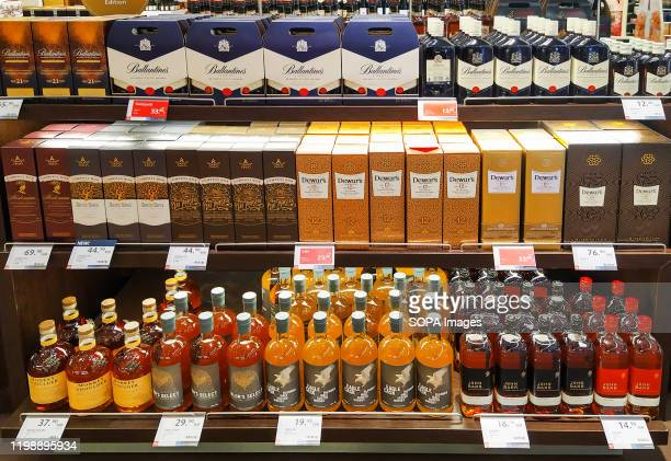 Bottles of various whiskey brands seen displayed at the Duty Free Store in Porto airport