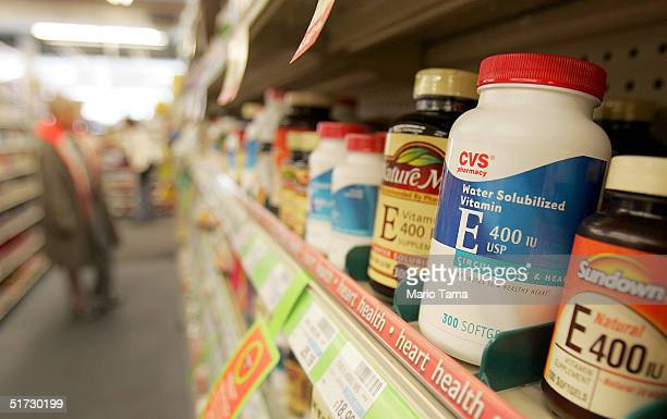Bottles of Vitamin E are seen in a CVS pharmacy November 11 2004 in New York City According to a new study dietary supplements of vitamin E can be...