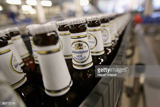 Bottles of wheat beer make their way down a conveyor belt at the Weihenstephan brewery on November 16 2009 in Freising Germany The Bavarian state...