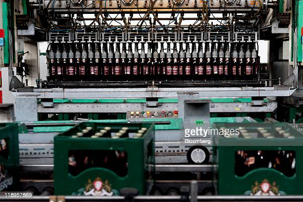 Bottles of wheat beer pass along the production line at Herrnbraeu Gmbh Co KG's brewery in Ingolstadt Germany on Tuesday July 12 2011 Wheat futures...
