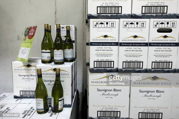 Bottles of white wine stand on display in the Majestic Wine Plc store in Calais France on Tuesday Aug 1 2017 Customs checks at the border after the...