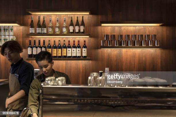 Bottles of wine are displayed behind a counter inside the Starbucks Corp Reserve Roastery store in Shanghai China on Friday May 11 2018 Starbucksis...