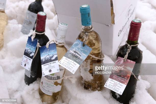Bottles of wine from the Chateau de Lugey by Bordeaux winemaker Franck Labeyrie are placed in snow at the ski station in Cauterets Pyrenees southern...