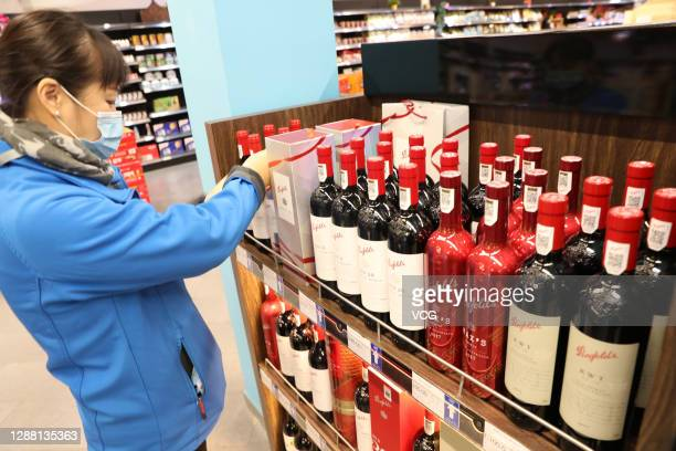 Bottles of wine imported from Australia are displayed for sale at a supermarket in Nantong Free Trade Zone on November 27, 2020 in Nantong, Jiangsu...