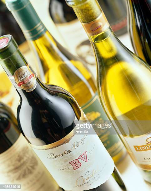 bottles of wine - chardonnay grape stock photos and pictures
