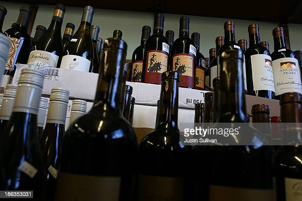 Bottles of wine sit on a shelf at Ludwigs Fine Wine and Spirits on October 30 2013 in San Anselmo California According to a report released by Morgan...