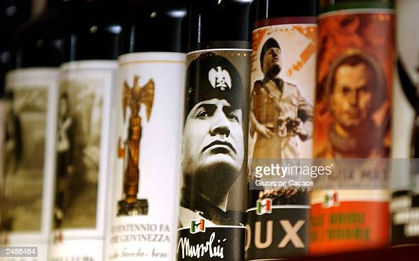 Bottles of wine with a label depicting Fascist dictator Benito Mussolini sit on a shelf in the cellar of 'Lunardelli Wine' September 12 2003 in...