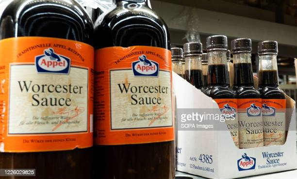 Bottles of Worcester Sauce produced by Appel company seen on a shelf at a store Worcester Sauce is frequently used to enhance food and drink recipes...