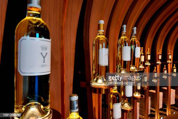 Bottles of Y Chateau d'Yquem dry white wine are displayed in the Chateau d'Yquem selling room in Sauternes southwestern France on January 28 2019...