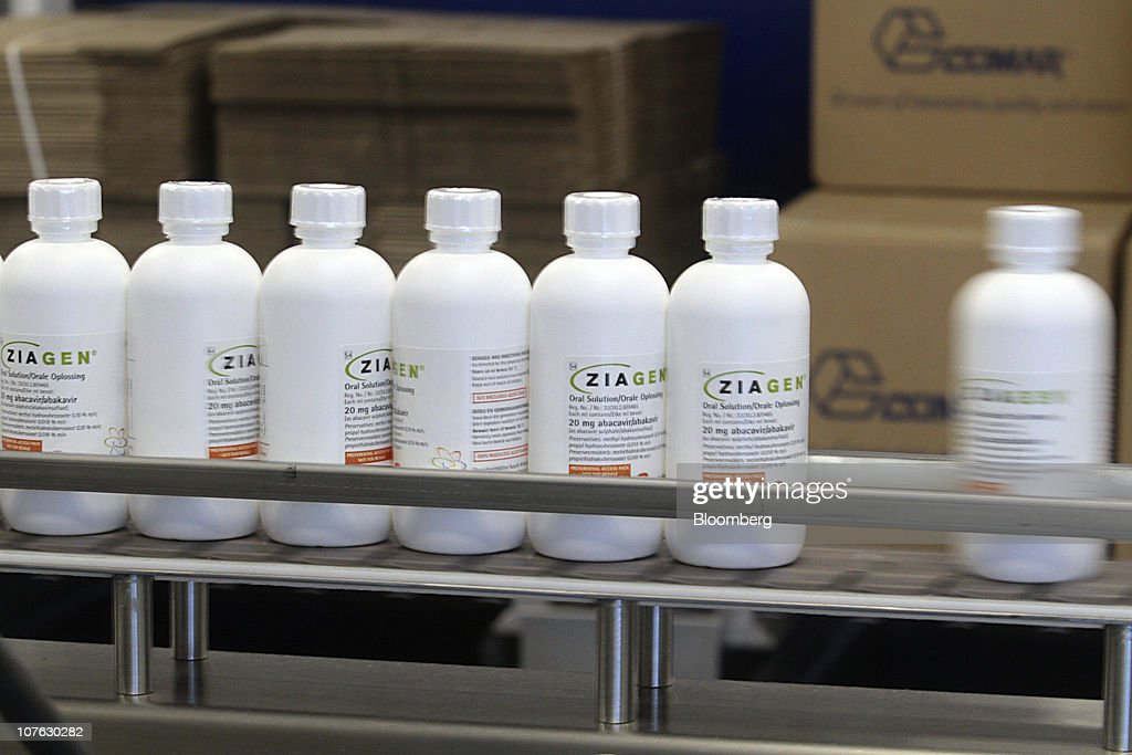 Bottles of Ziagen, an HIV oral liquid medication, move down the packaging line at the GlaxoSmithKline Canada Inc. headquarters in Mississauga, Ontario, Canada, on Monday, Dec. 13, 2010. Global sales of existing HIV medicines will peak at $12 billion in 2012, then halve by 2019 as patent expiries increase competition from generic drugs, according to a report by Datamonitor Group earlier this year. Photographer: Norm Betts/Bloomberg via Getty Images