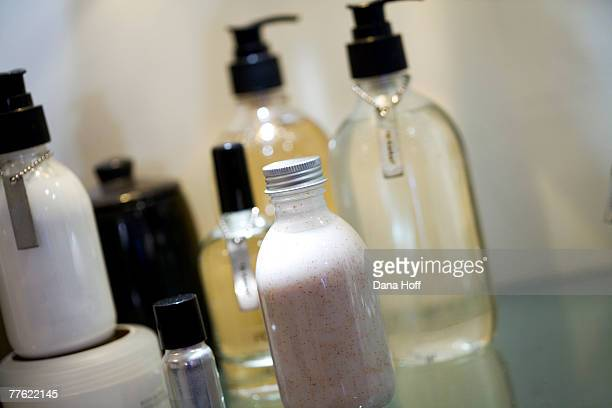 Bottles, pump dispensers, and containers of toiletries