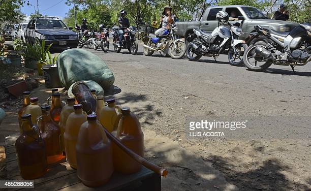 Bottles with smuggled gasoline are seen next to a line of motorcycles in Cucuta, Colombia, in the border with Venezuela on August 26 as the border...