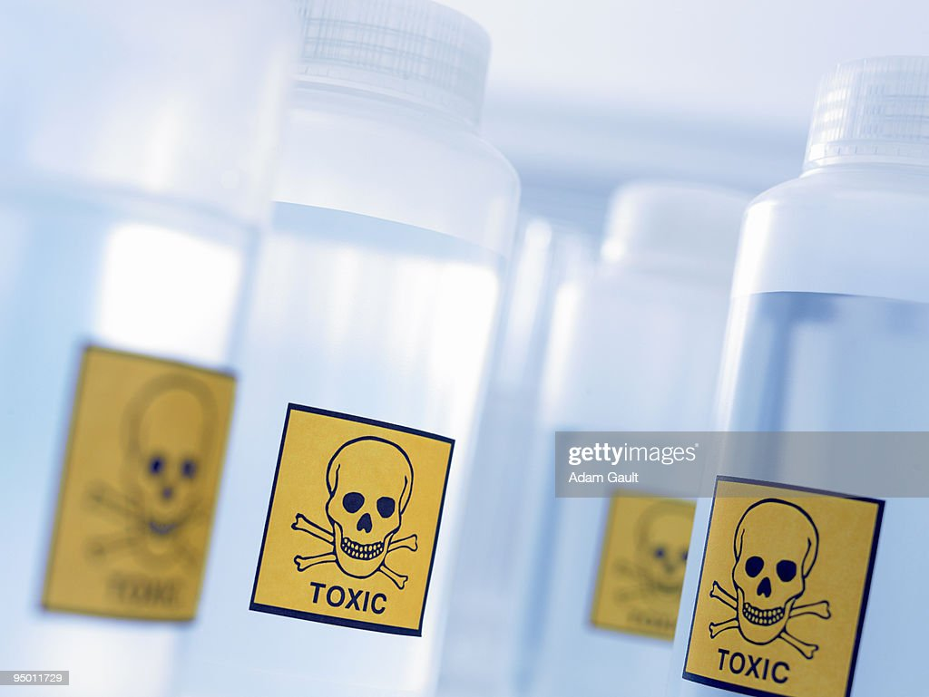 Bottles with toxic labels : Stock Photo