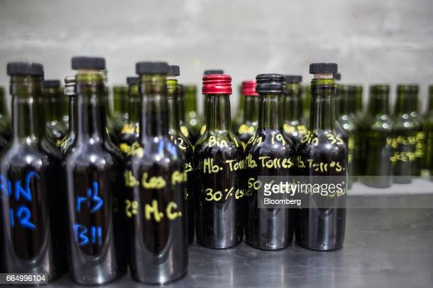 Bottles with various wine samples sit at the Bodega Santa Julia production facility in Mendoza Argentina on Tuesday March 23 2017 The Argentine wine...