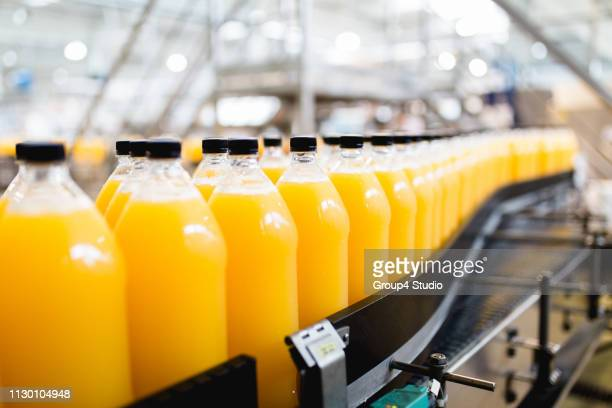 bottling plant - making stock pictures, royalty-free photos & images