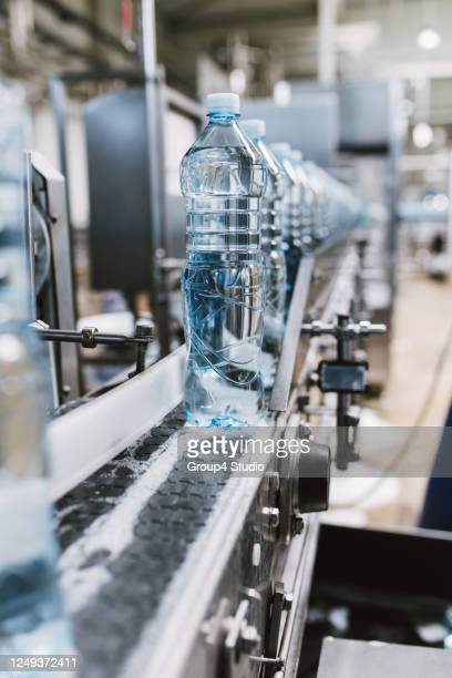 bottling plant - in a row stock pictures, royalty-free photos & images