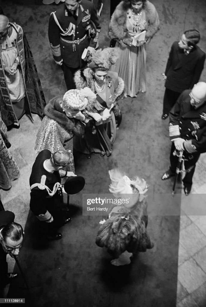 King George VI (1895 - 1952) and Queen Elizabeth the Queen Mother (1900 - 2002) at Westminster Abbey, London, at the wedding of Princess Elizabeth (later Queen Elizabeth II) and Prince Philip, 20th November 1947. At centre, left is Queen Mary (1865 - 1936). Original Publication: Picture Post - 4438 - Royal Wedding - pub. 1947