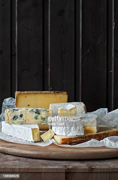 Bottom left hand side triangle shaped with the front bit cut off is called Brie, a soft cows' milk cheese originating in France. It can be served in...