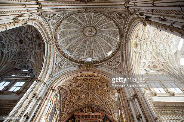 CONTENT] Bottomup view of the exquisitely decorated dome and ceiling of the capilla mayor of the MosqueCathedral of Cordoba It is a World Heritage...