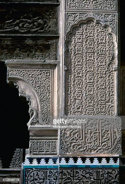 'Bou Inaniyya Madrasa 13501355 14th Century stuccowork Morocco Fes Whole artwork view View of the upper walls thickly decorated with carved cedar...