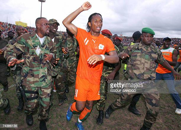 Ivory Coast Elephants striker Didier Drogba is escorted by Ivoirians rebels soldiers from the New forces after African Nations Cup 2008 qualifying...