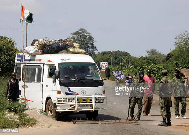 Members of the Armed Forces of the New Forces , rebels controlling the mainly Muslim northern half of the country, control road traffic at a...