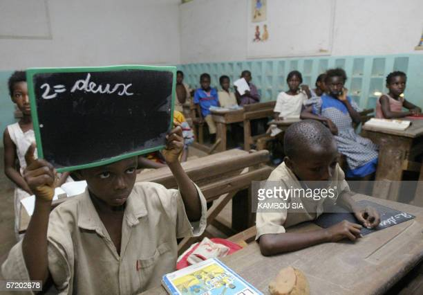 Primary school students in Bouake attend lessons in a classroom 28 March 2006 where the university in the central Ivory Coast town officially...