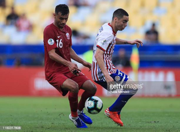 Boualem Khoukhi of Qatar and Miguel Almirón of Paraguay compete for the ball during the Copa America Brazil 2019 group B match between Paraguay and...