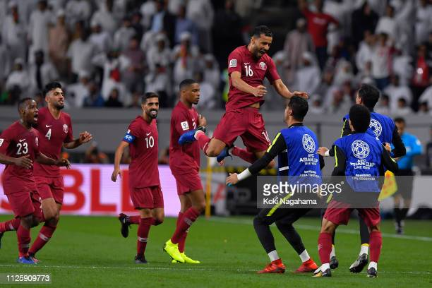 Boualem Khoukhi of Qatar celebrates with his team after scoring their first goal during the AFC Asian Cup semi final match between Qatar and United...